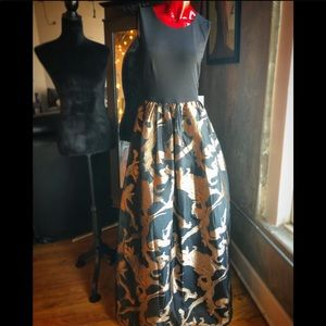 Black ballgown with gold-detailed skirt